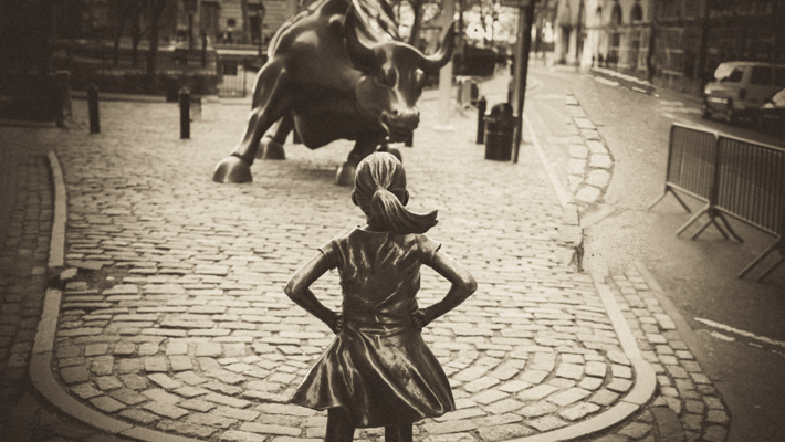 Fearless Girl Charging Bull Statue Photo by William Canady from Pexels