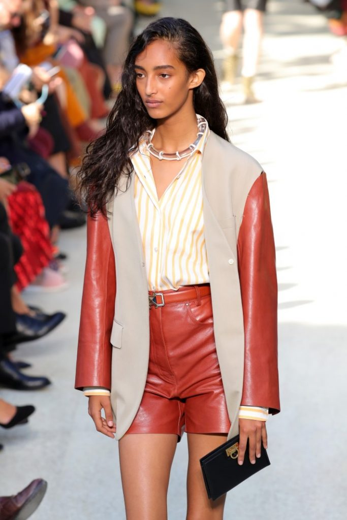 A model walks the runway in a red leather short suit at the Salvatore Ferragamo show during the Milan Fashion Week Spring/Summer 2020. (Photo by Andreas Rentz/Getty Images)