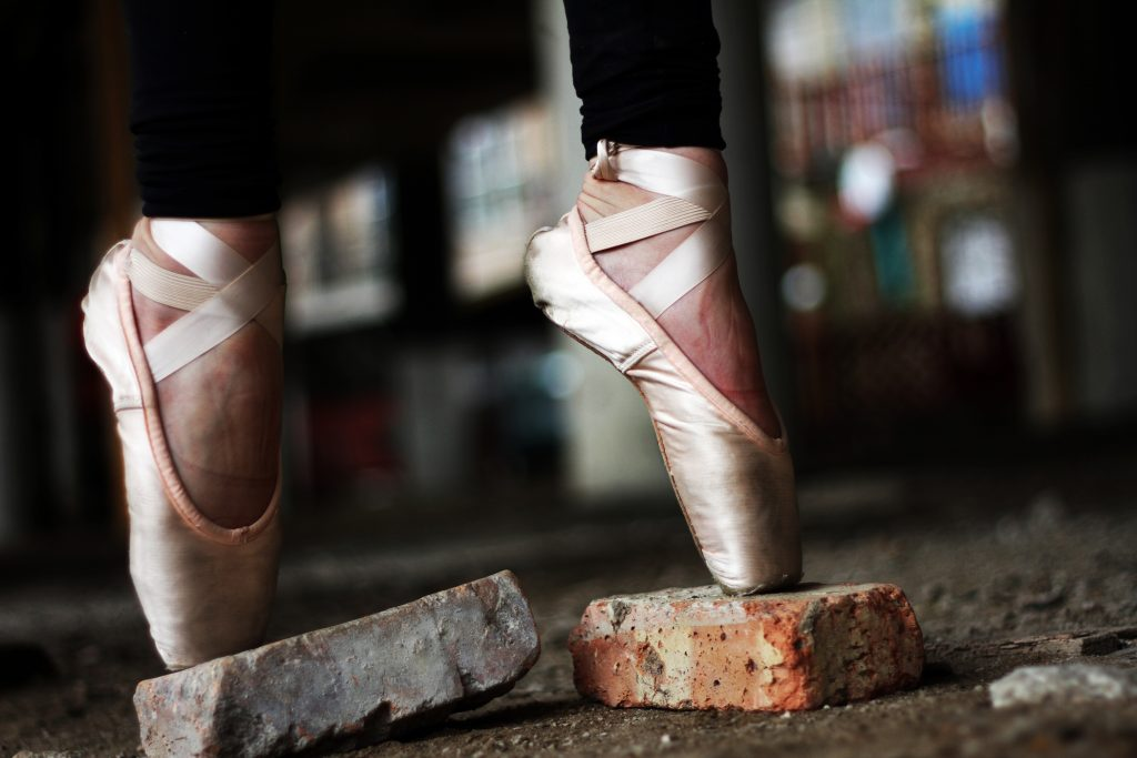 ballerina on her toes - Ways to Develop a Winning Mindset