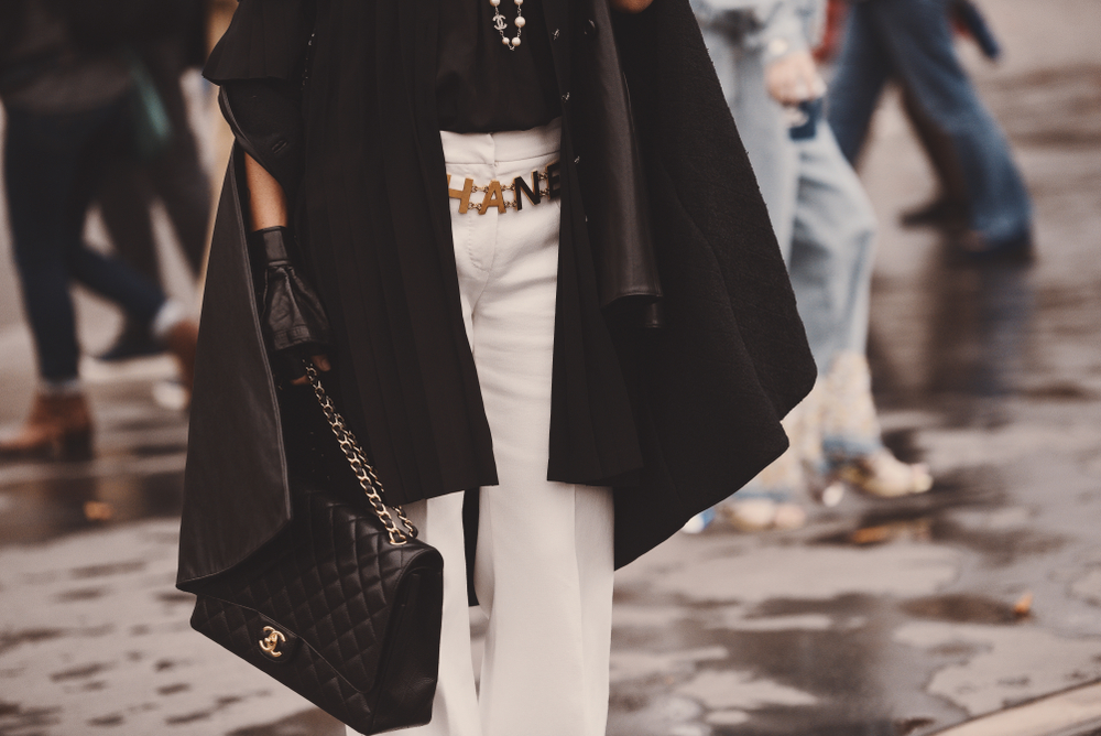 October 2, 2018: Paris, France - Fashionable girl wearing a Chanel bag outside a fashion show during Paris Fashion Week - PFWSS19 - g7 fashion pact - positive fashion