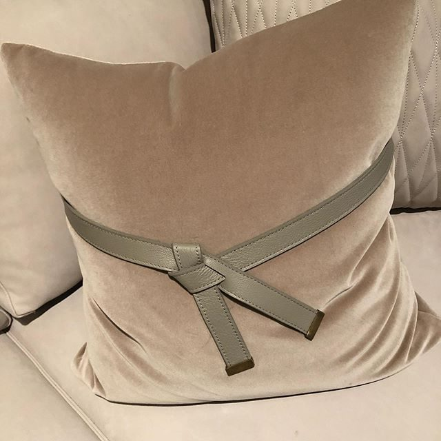 velvet pillow with belt detailing