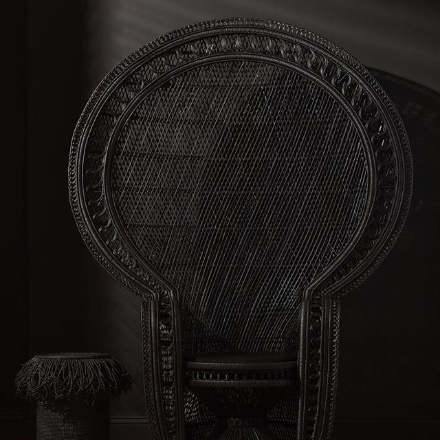 woven materials 2020 interior design trends to watch - black woven raffia chair by mcguire furniture