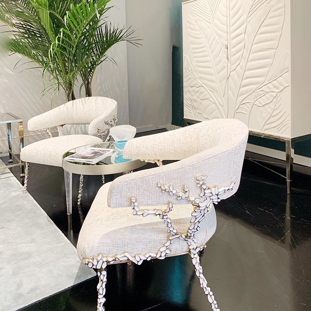 chair featuring nature motif and cabinet with leaf motif by caracole home