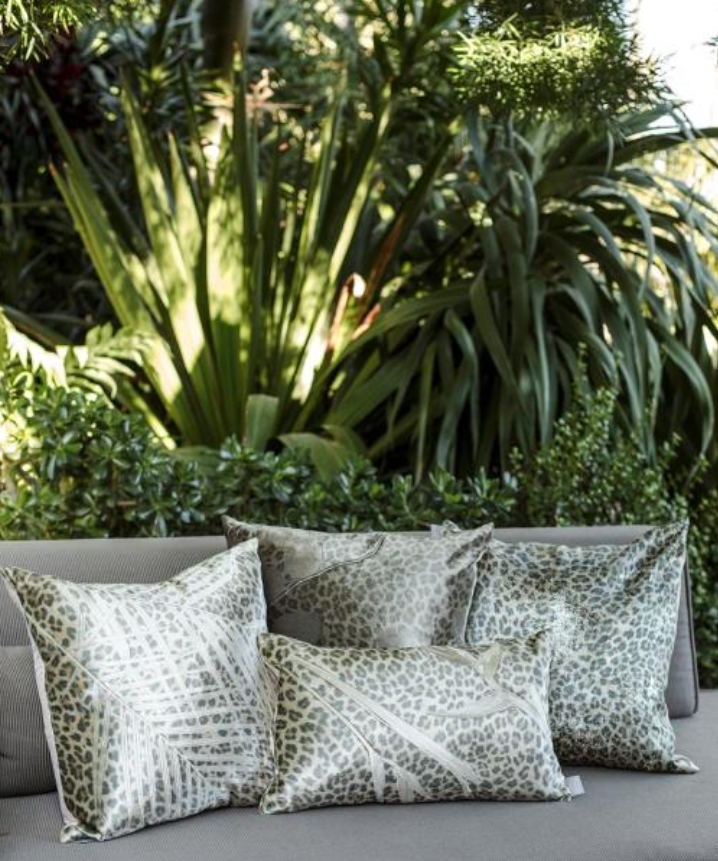 snow leopart trust accent pillows by aviva stanoff design