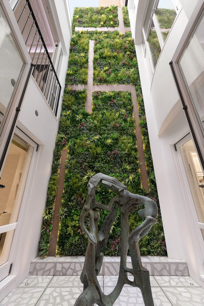 cadogan place courtyard with green wall prime construction refurbishment by london projects
