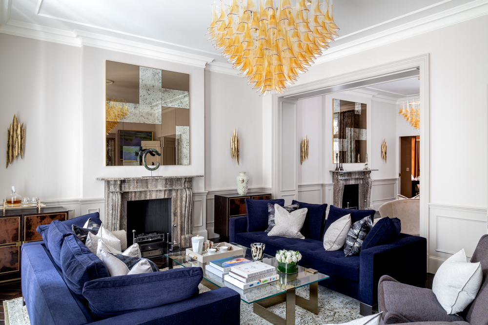 luxury living room design with blue sofas and gold lighting