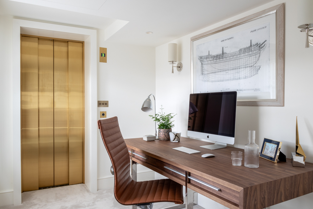 gold lift doors in a private residence office in london