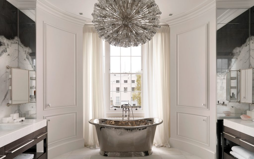 hanover terrace luxury bathroom design with silver bathtub and marble paneling