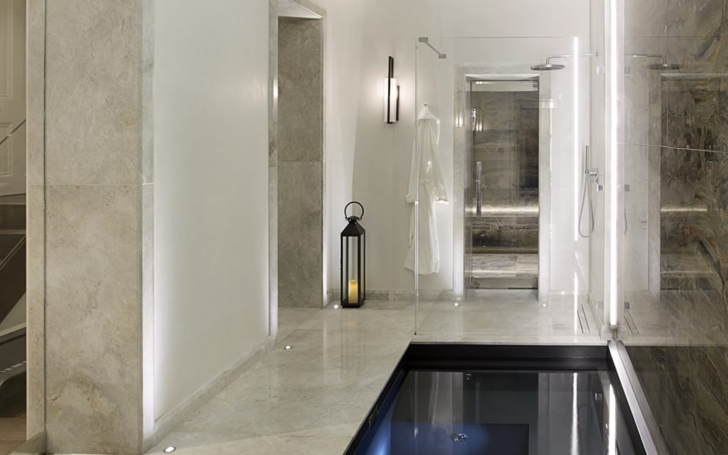 human-centric lighting in a marble bathroom with a plunge pool