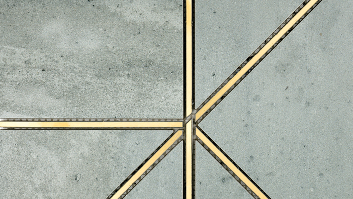 marble tiling with metal detail
