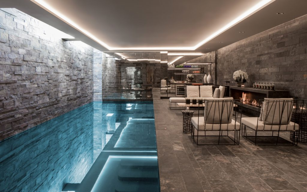 tregunter underground pool with rooflights and stone walls