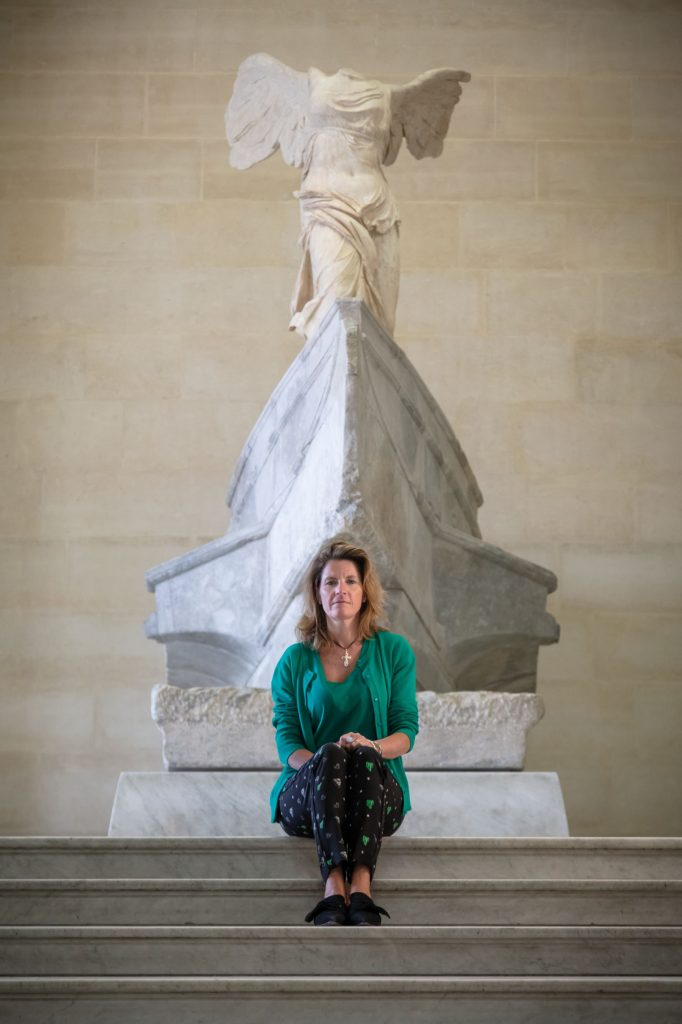 Alienor Massenet at the Louvre in front of the painting that inspired his scent, the Winged Victory of Samothrace