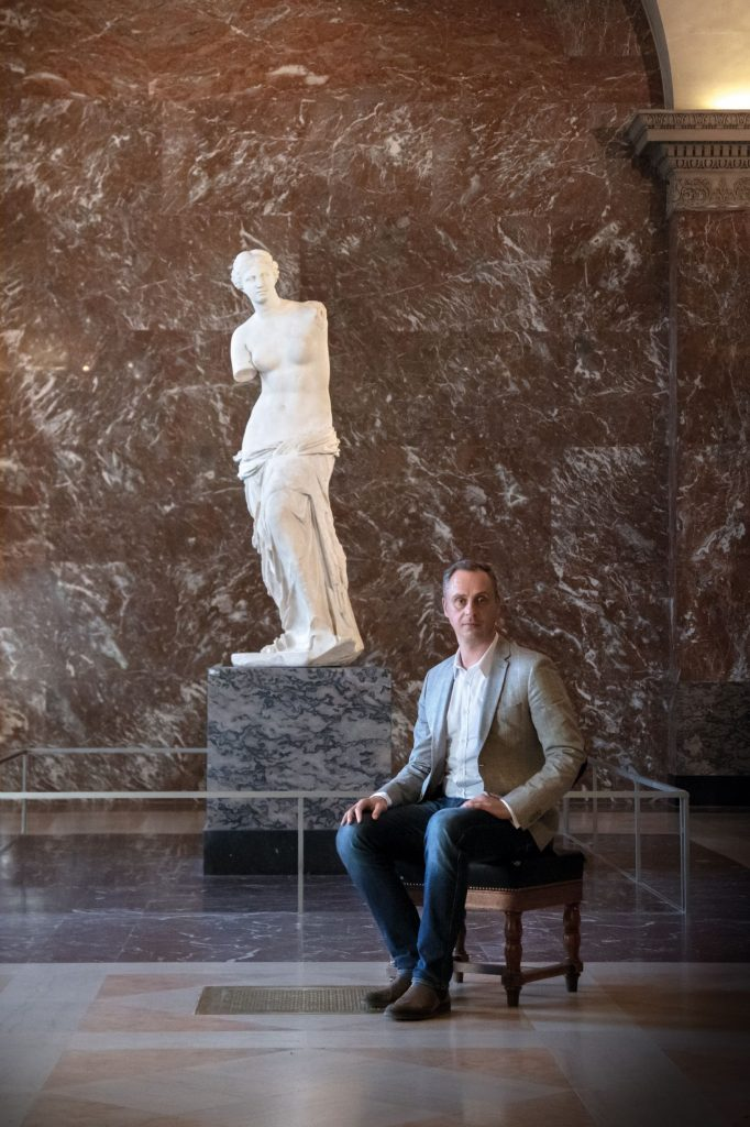 Jean Christophe Herault at the Louvre in front of the painting that inspired his scent, the infamous Venus de Milo statue