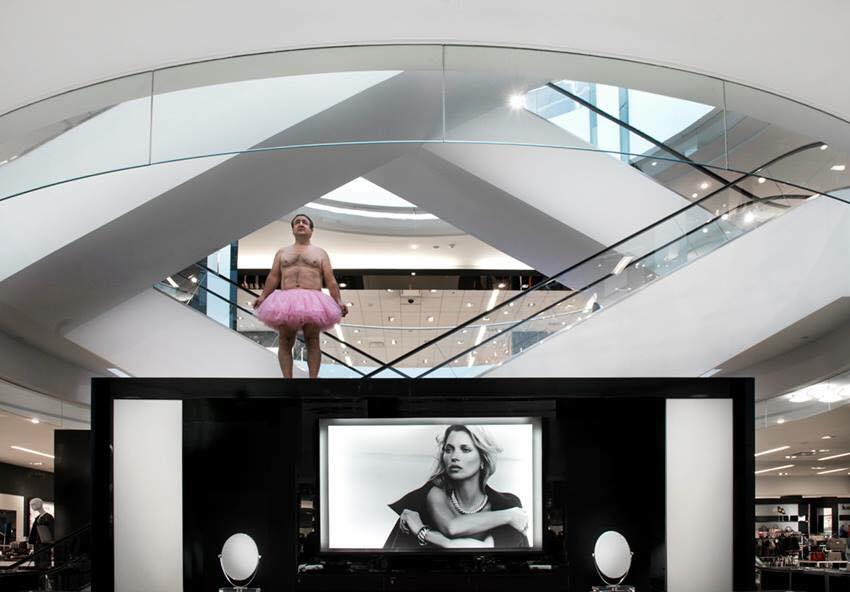 bob carey in pink tutu in the Cosmetic Department. Bloomingdale's, Chevy Chase, Maryland