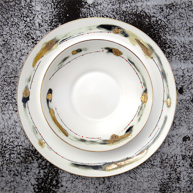 Fine handpainted porcelain dinnerware by Daniel Levy with 24K gold detailing