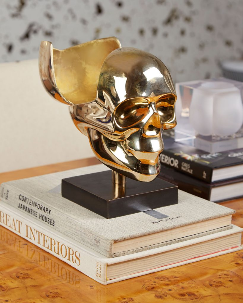 Polished brass skull box on a blackened brass base by Jonathan Adler
