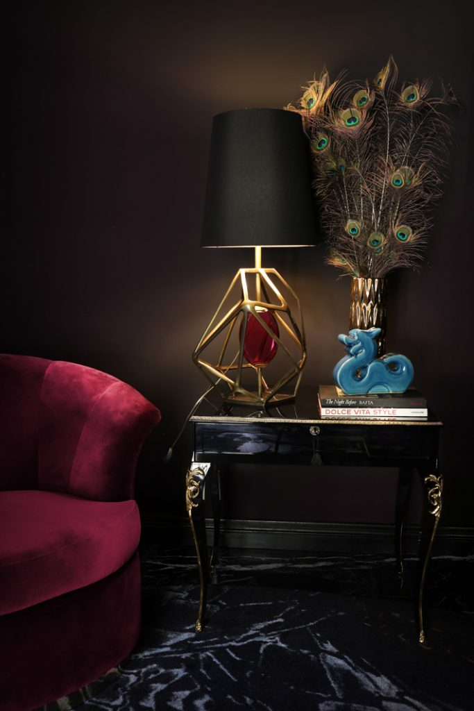besame chair, cabriole nightstand and gem table lamp by koket in a dark interior design theme