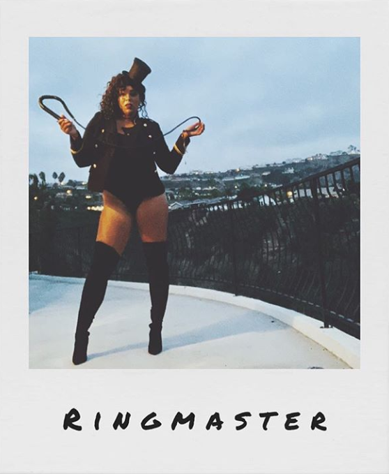 woman dressed as a ringmaster