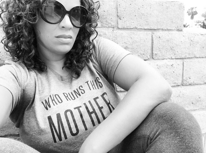 woman wearing who runs this mother shirt - 40 things before 40 list