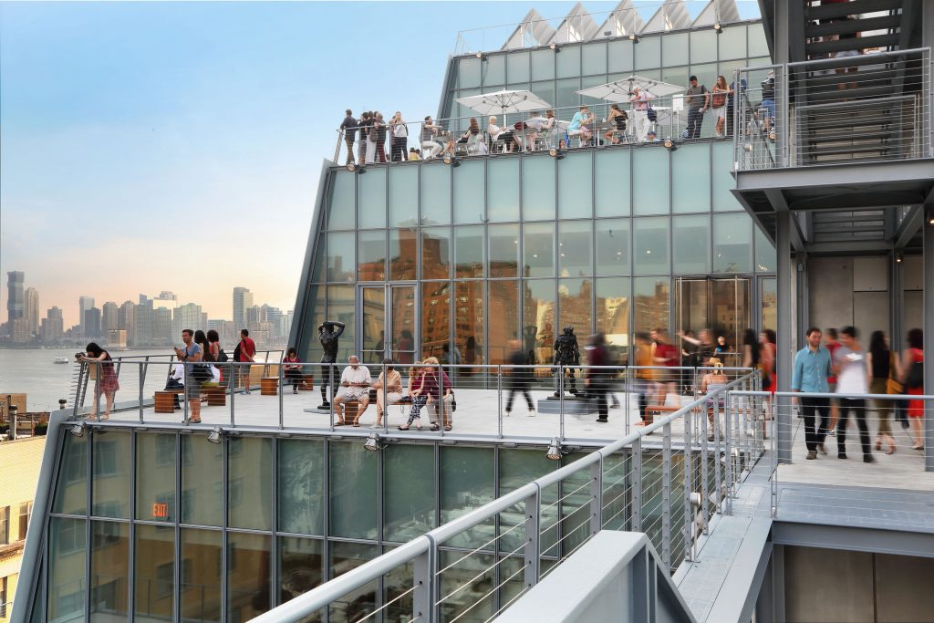 People enjoying the terrace of the Whitney Museum of Modern Art at the Meatpacking District, New York