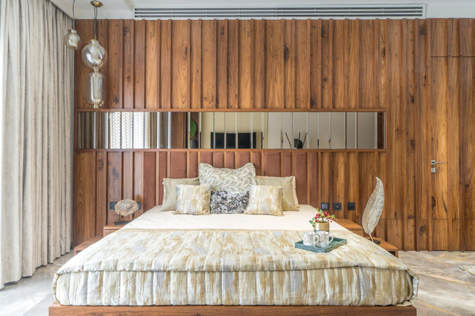 bedroom designed by baheti & associates with wood paneling