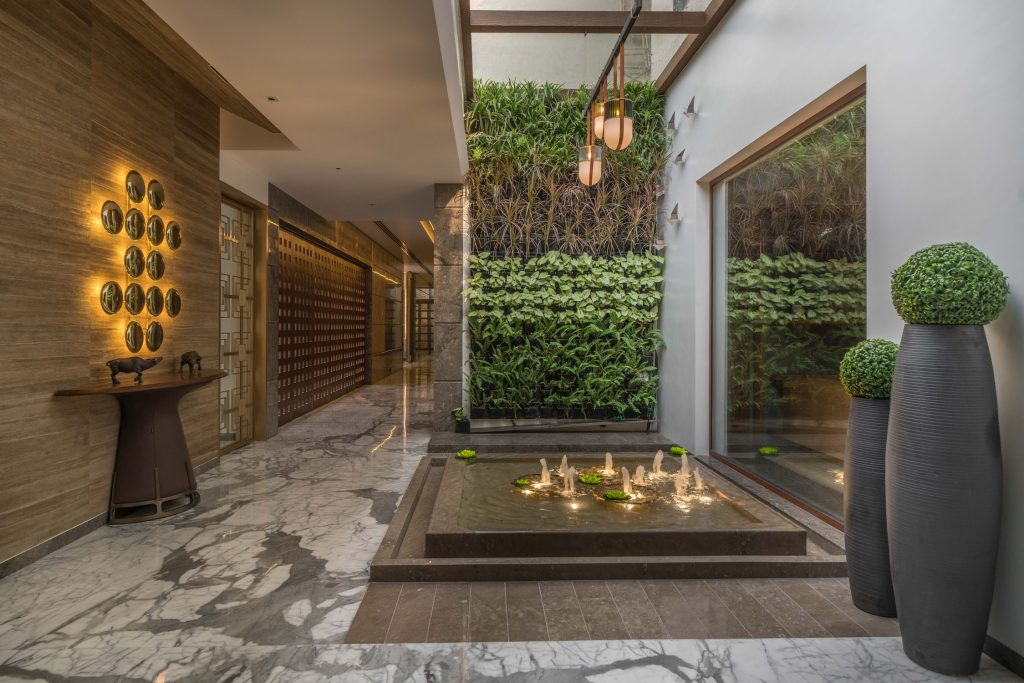 courtyard entry in multigenerational home in india - the bangur house - designed by baheti & associates