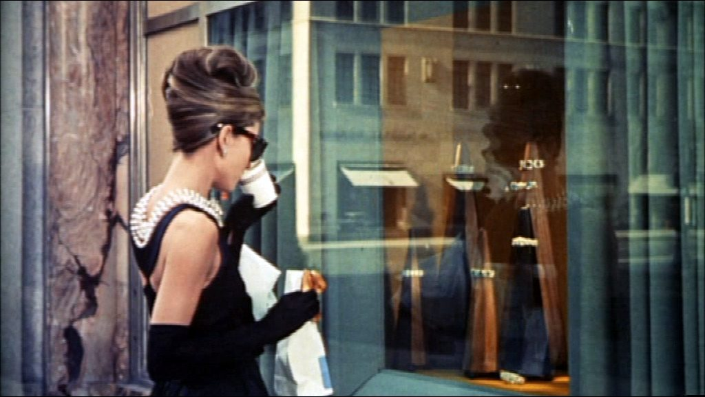 Audrey Hepburn wearing one of Coco Chanel's famous little black dress designs in Breakfast at Tiffany's, 1961