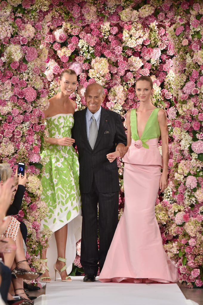 Designer Oscar de la Renta (C) and model Karlie Kloss (L) walk the runway at the Oscar De La Renta fashion show during Mercedes-Benz Fashion Week Spring 2015, September 2014 in New York City