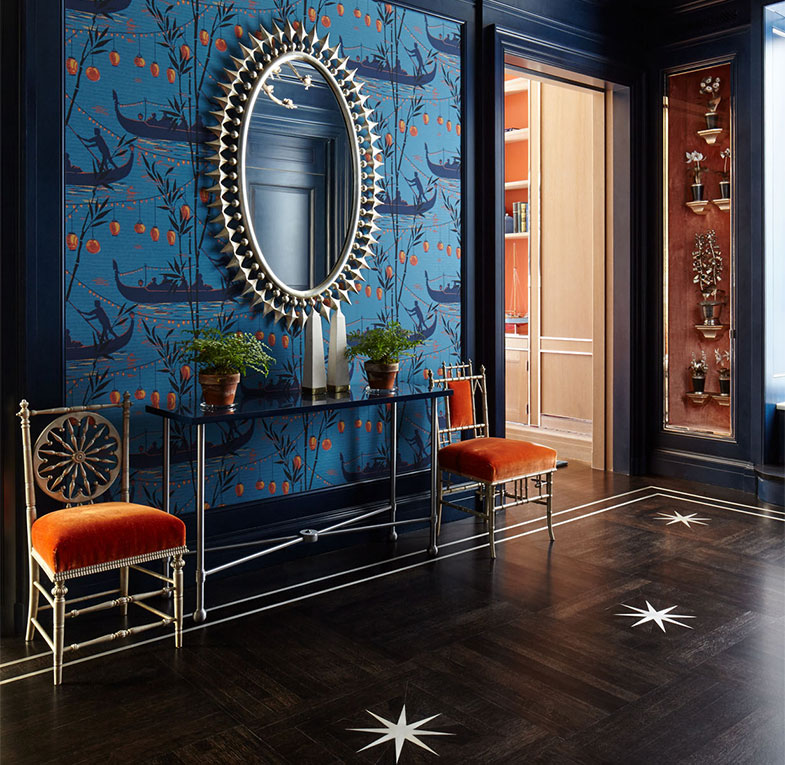 A luxurious hallway in a New York penthouse designed by Nina Campbell featuring Cole & Son's Gondola wallpaper.