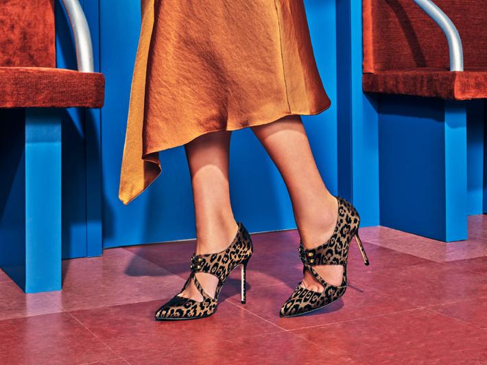 woman wearing leopard print pumps