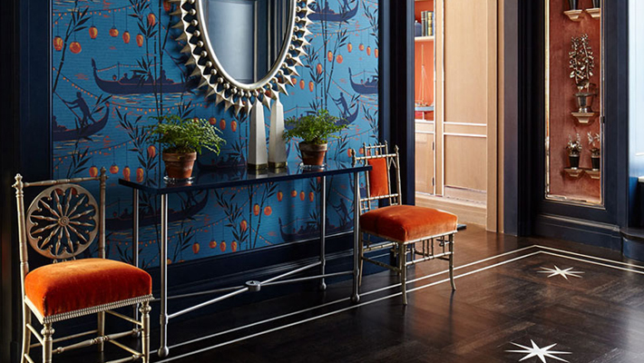 nina campbell ny penthouse entrance featuring cole & son gondola wallpaper