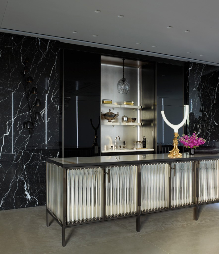 dream kitchen with black marble and glass island