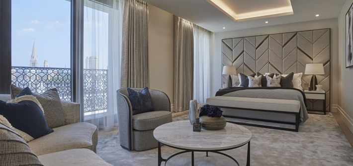 luxury master bedroom design in neutral colors with decorative detailing - Chelsea Barracks by Qatari Diar (Photo by Ray Main on behalf of Elicyon)
