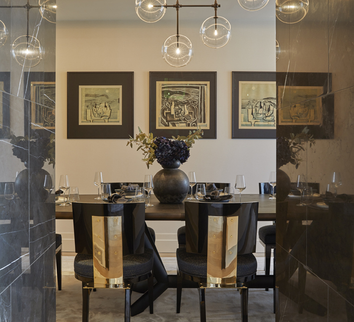 luxury dining room design featuring black marble and gold accents Chelsea Barracks by Qatari Diar