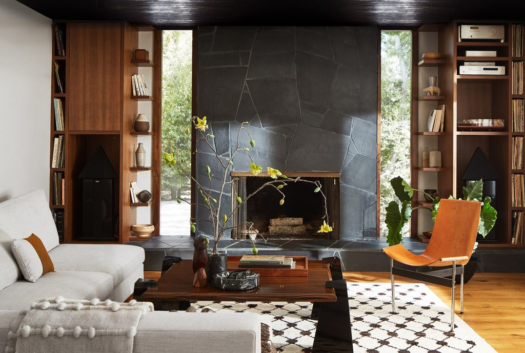 living room in a los altos home with a stone fireplace