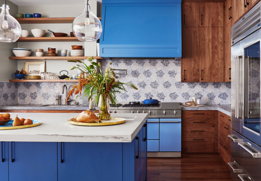 blue and white kitchen with wood cabinets in 25th Street Home