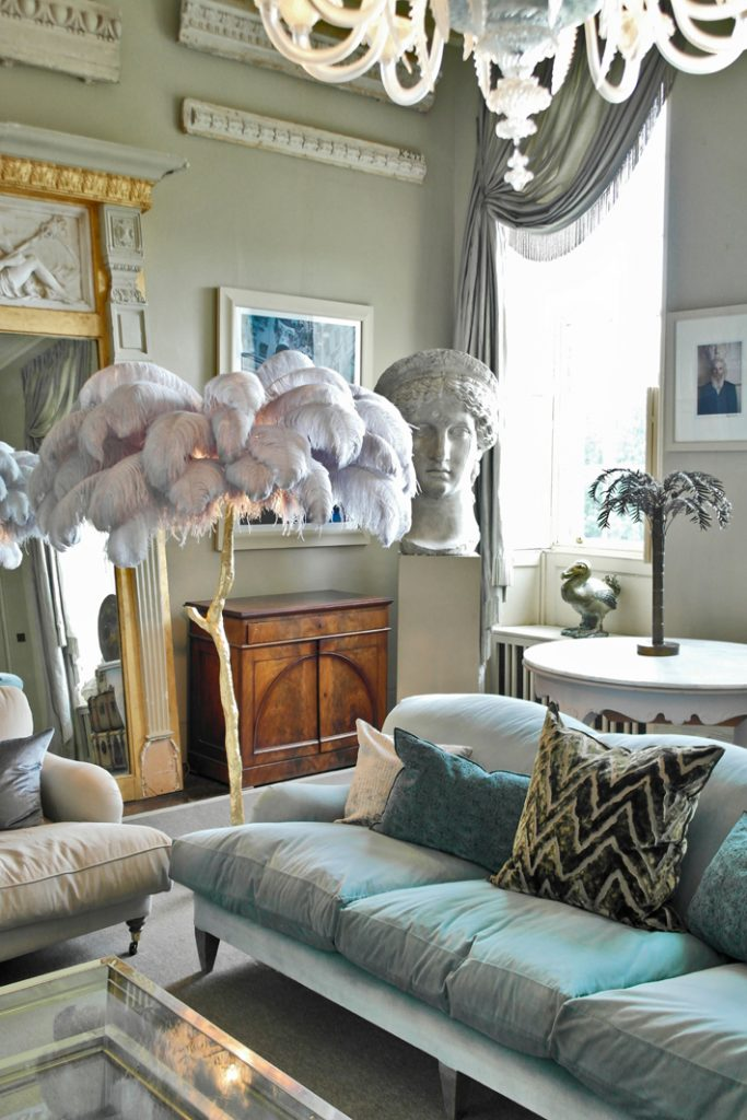 a modern grand tour Ostrich Feather Lamp and antiques
