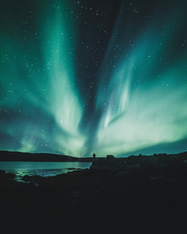 Romantic Weekend Getaways: Iceland - Photo of the shifting aurora in the shape of a wing by Luke Stackpoole