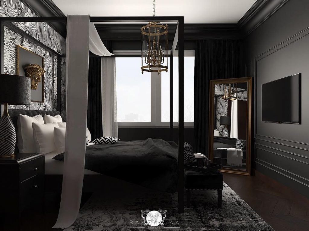 Wallpaper accent wall in a bedroom designed by Ramzy Alaa