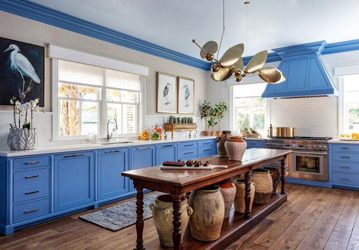 Kitchen design with blue cabinets by Sarah Blank