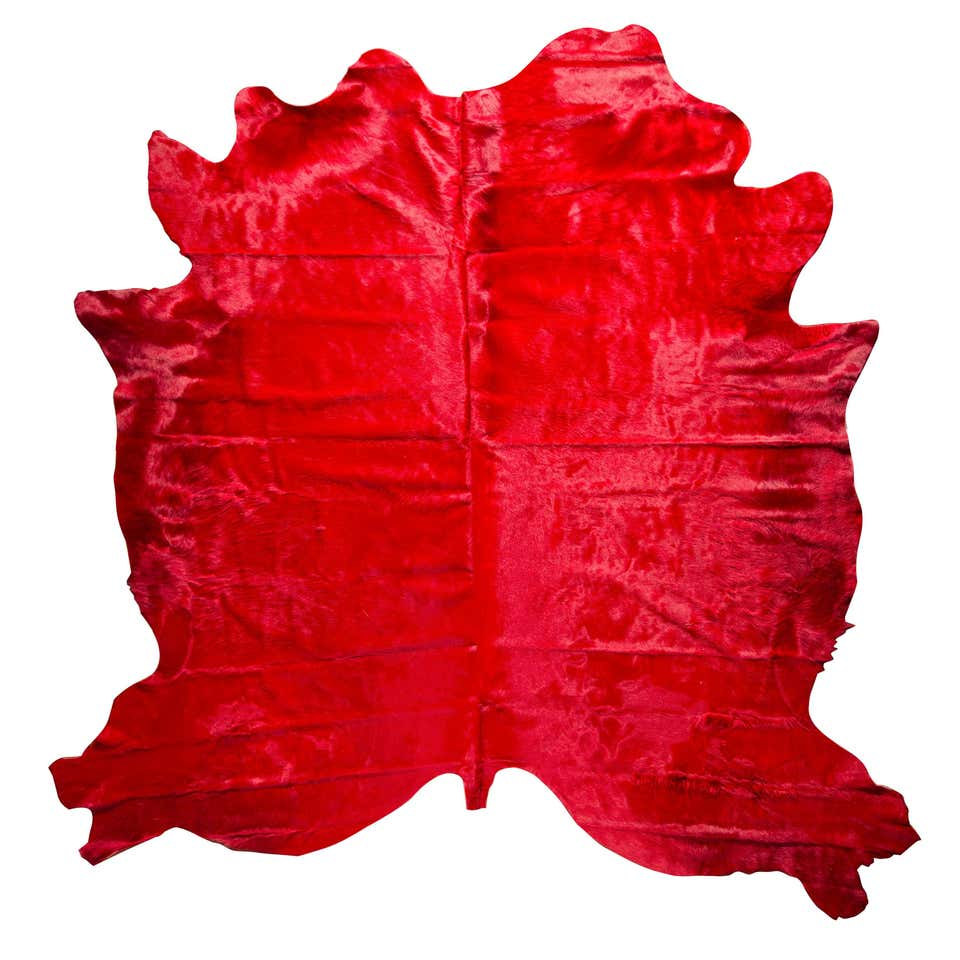red cowhide rug