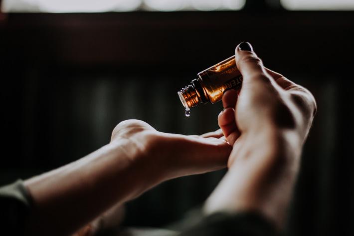 woman applying serum for perfect skincare regime - photo by christin hume via unsplash
