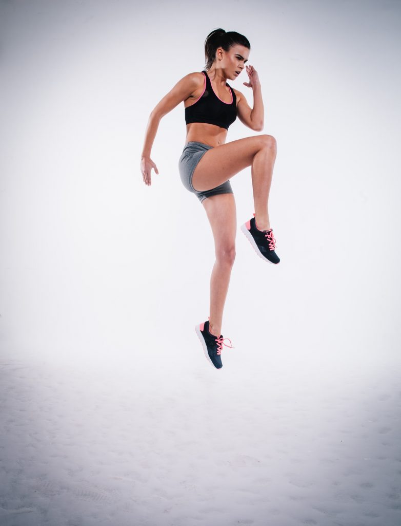 woman exercising - no pain no gain - how to be successful - photo by clem onojeghuo