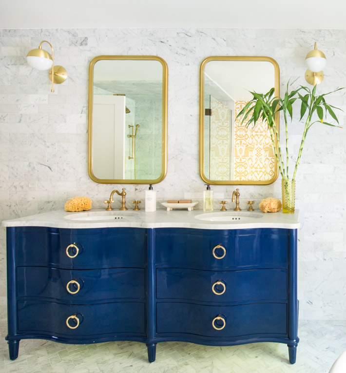 blue and white bathroom design with a blue vanity by D2 Interieurs (Photo by Jane Beiles)