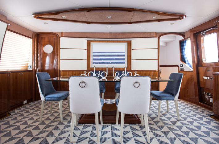blue and white Yacht dining room design by S-B Long Interiors