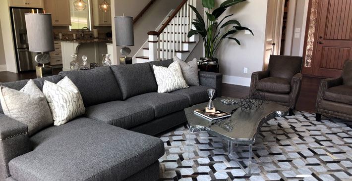 A cozy living room furnished with Century sofa designed by Designing Women Inc
