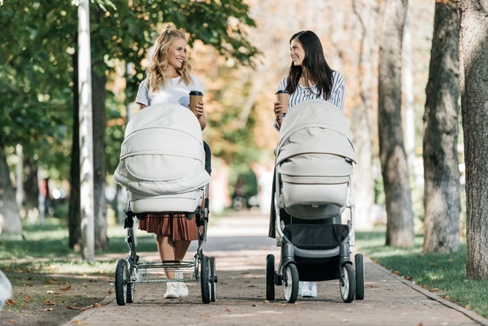 mom friends walking with strollers