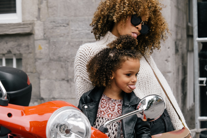 mother and daughter sticking tongues out, bonding, parenting and attachment style