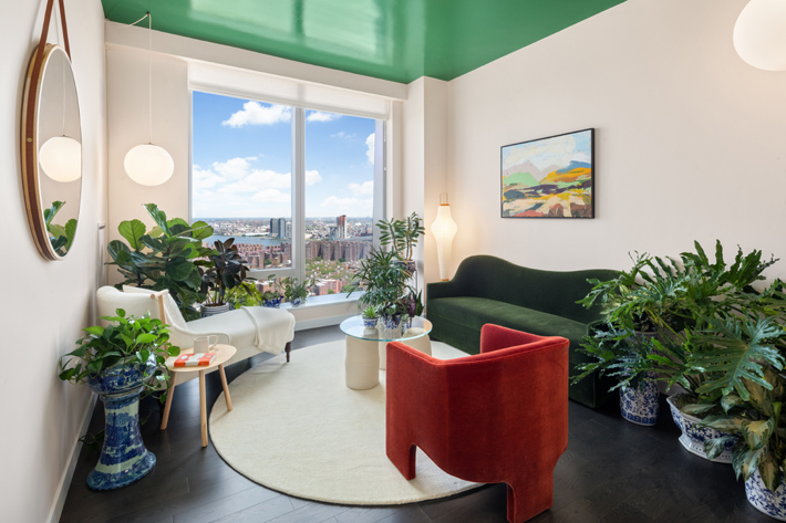 one manhattan square living room with stunning nyc views designed by anna karlin - million dollar listings nyc