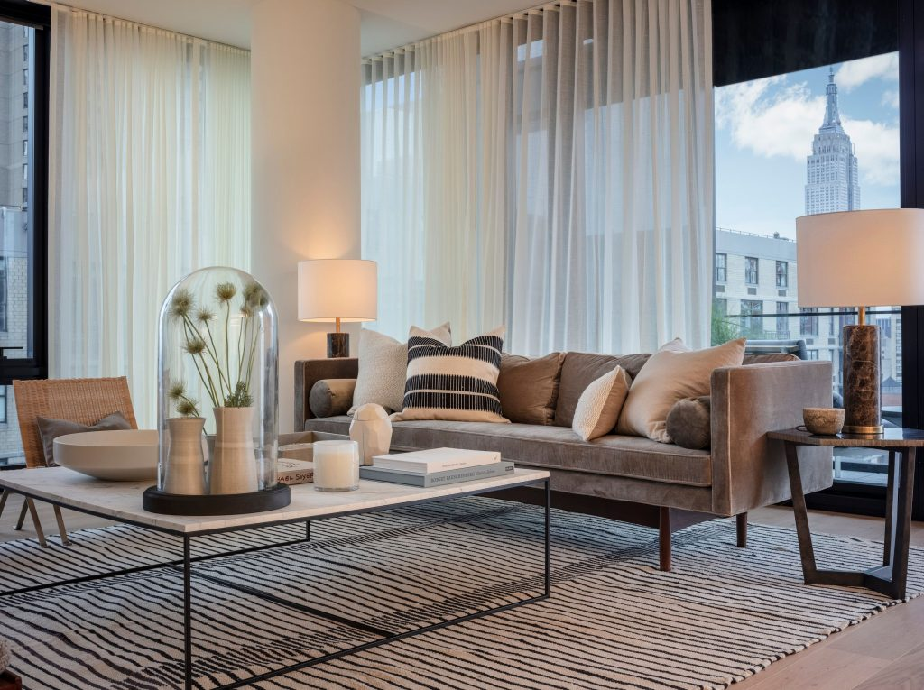A soothing living room design at One United Nations Park designed by rebbeca robertson interiors